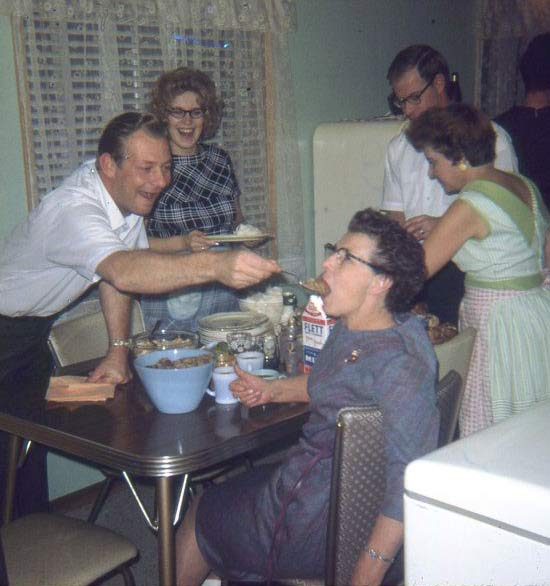 vintage snap putting food in grandma's mouth