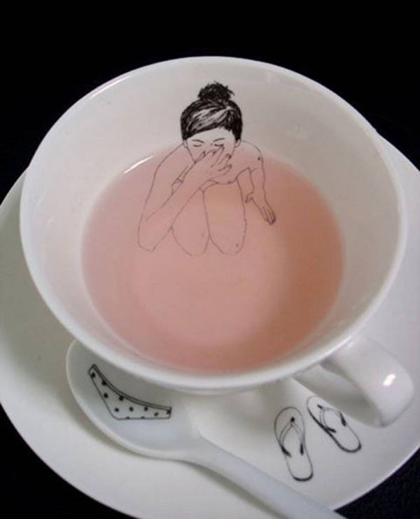 33 Funny Random Pics ~ cool tea cup art woman holding her nose