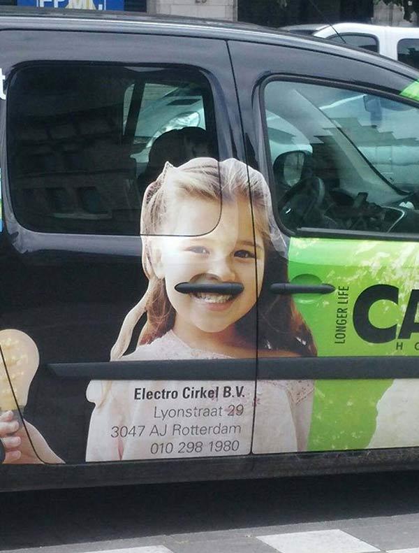 ad placement fails: doorhandles mustache on girl