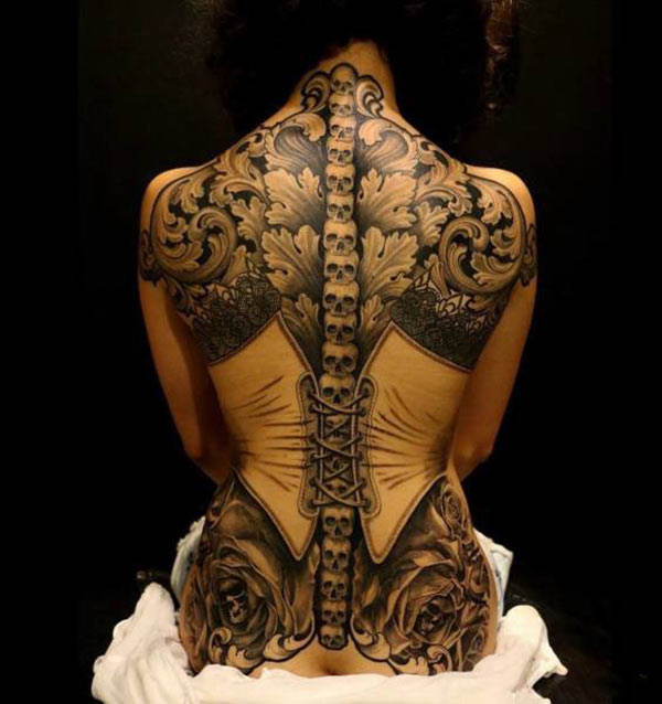 35 Funny Pics ~ awesome back tattoo ! corset skulls