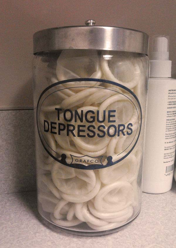 33 Funny Pictures ~ Doctors office jar tongue depressors condms