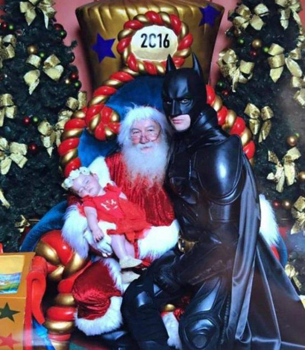 Funny Christmas: Batman sitting on mall Sant's lap