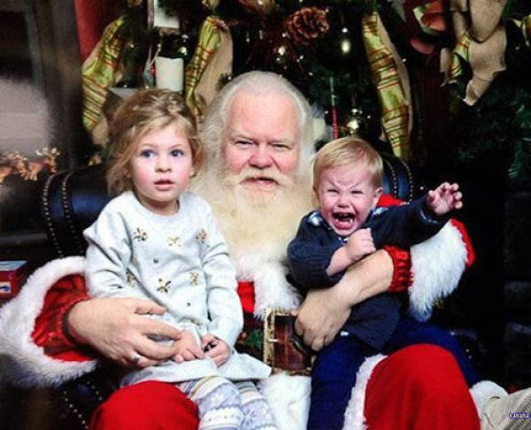 41 Funny Christmas Photos ~ screaming baby on creepy Santa's lap