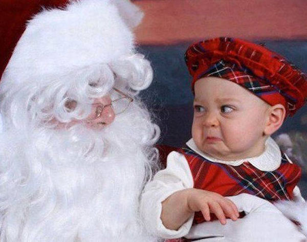 41 Funny Christmas Photos ~ mad baby on creepy Santa's lap