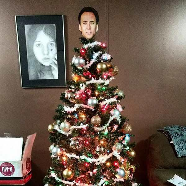 41 Funny Christmas Photos ~ Nicolas Cage tree topper angel