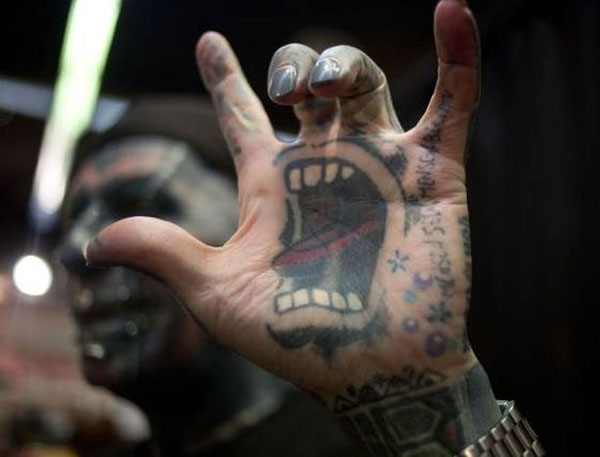 open screaming mouth tattoo hand palm