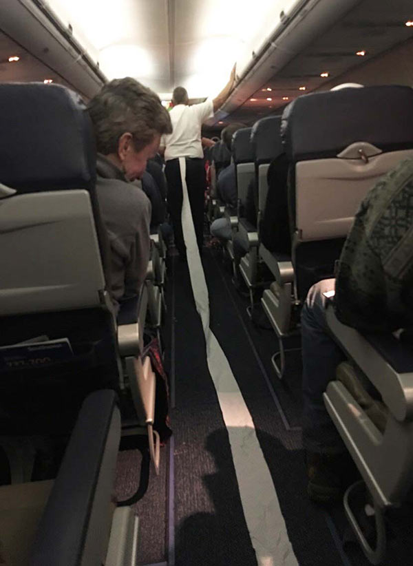 Funny Pics & Memes ~ Woman walking down airplane aisle with toilet paper hanging from her pants