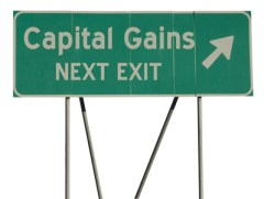 Green road sign capital gains