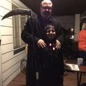 David Grady posing with his son at Halloween