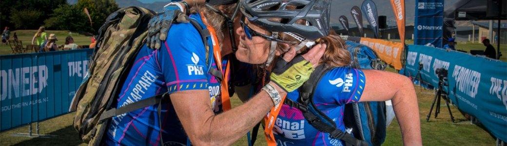 Patty George hugging Pioneer Race teammate Hap Farber