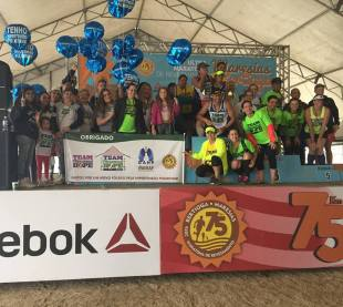 Team PH USA and Team PH Brazil on stage with patients from all over the country.