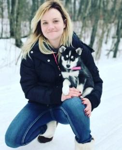 Paulina holding her husky