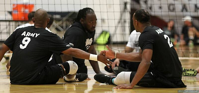 wheelchair volleyball joystick marines army to play for sitting gold at warrior games thomas davis veteran anthony pone and sgt delvin maston talk after a point on sunday against special operations the 2013 presented by