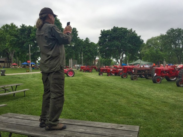 photo of Jim photographing red tractors