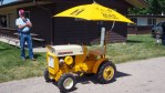 photo of lawn tractor with umbrella
