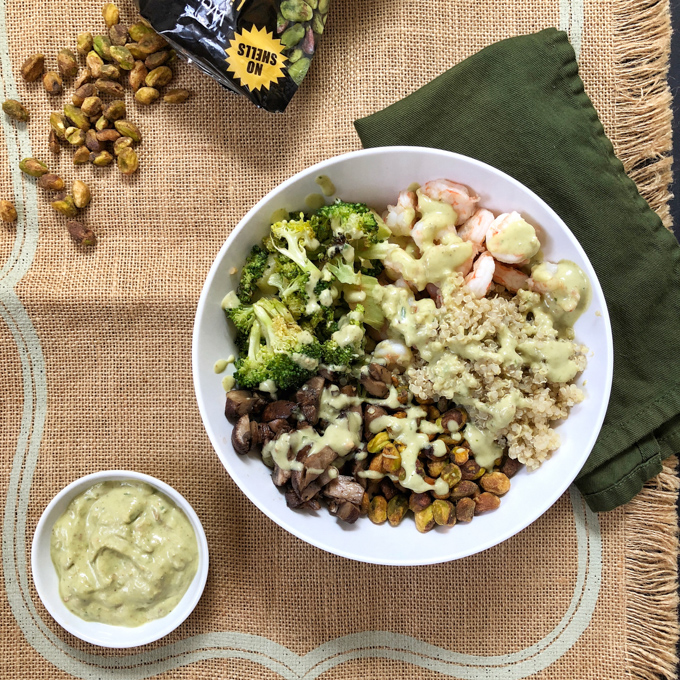 Made with roasted broccoli, shrimp and mushrooms, served with quinoa and a creamy pistachio yogurt, this buddha bowl is bursting with nutrients and yummy flavors! Recipe at Teaspoonofspice.com #buddhabowls #pistachios #shrimp #proteinbowls