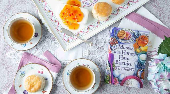 Uncover a Fatal Secret in Murder with Honey Ham Biscuits by A.L. Herbert