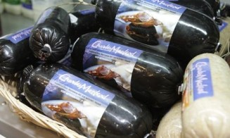 Black pudding in the dairy case at the airport.