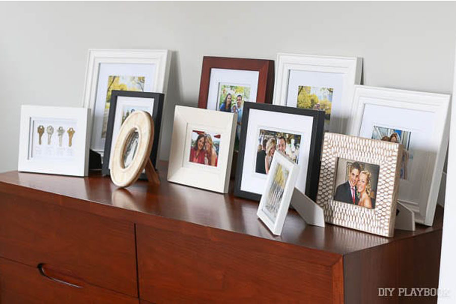 A Cluttered Display of Photos on Furniture