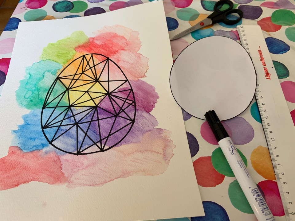 Eye-catching graphic watercolour Easter art: finished product, with tools needed to make it including the 'form'