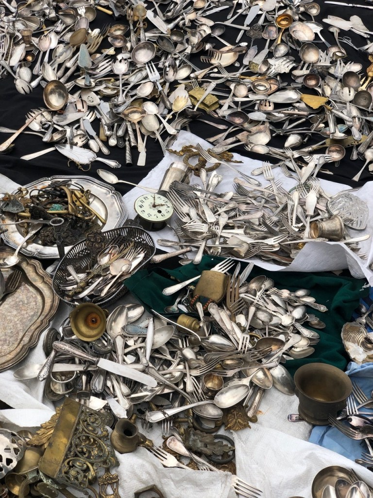 Piles of cutlery at the flea market
