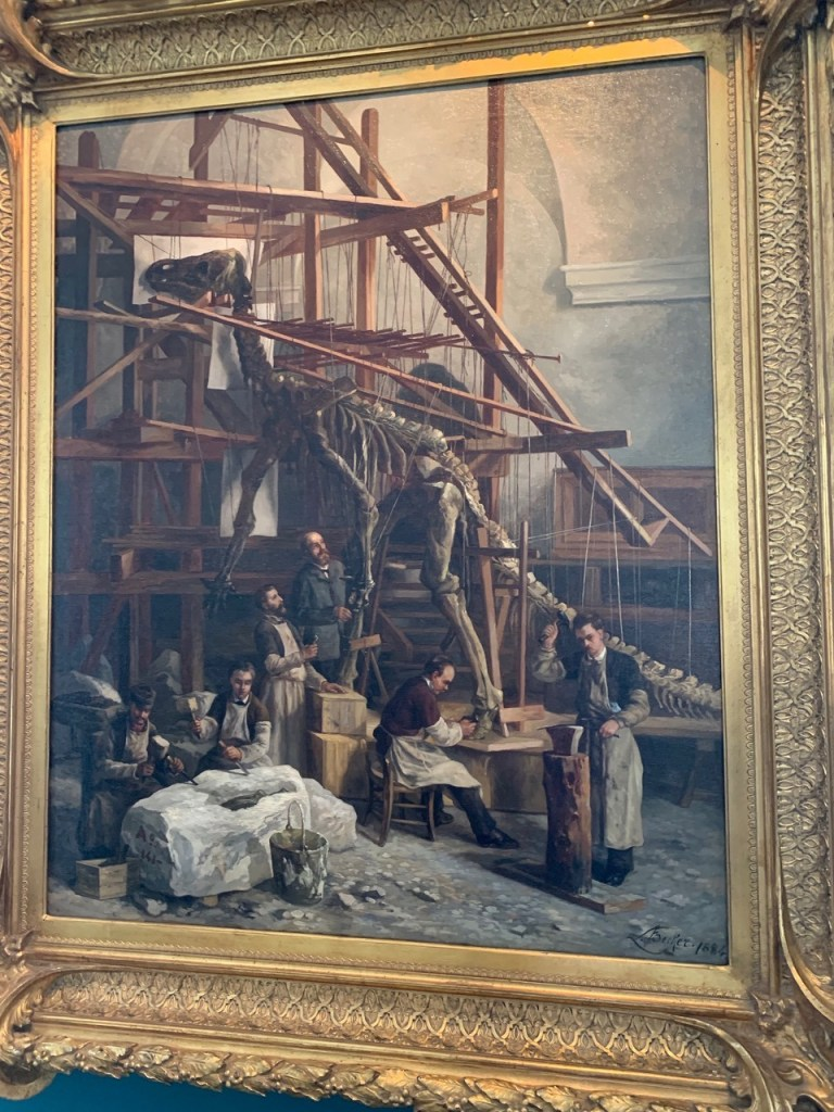 Painting of mounting the Iguanodons