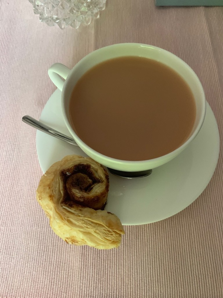 Cup of tea and a freshly-baked cinnamon snail for tea with Mum