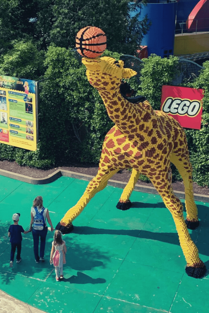 Giant giraffe playing basketball all made of Lego; one of the many Lego creations to admire at Legoland Deutschland. Princesses, dinosaurs and Lego: Day trips in and from Munich.