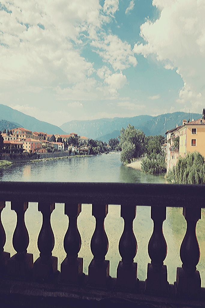 The view from the wooden bridge in Bassano di Grappa, an icon of the one fo the best small towns to visit in the north of Italy.
