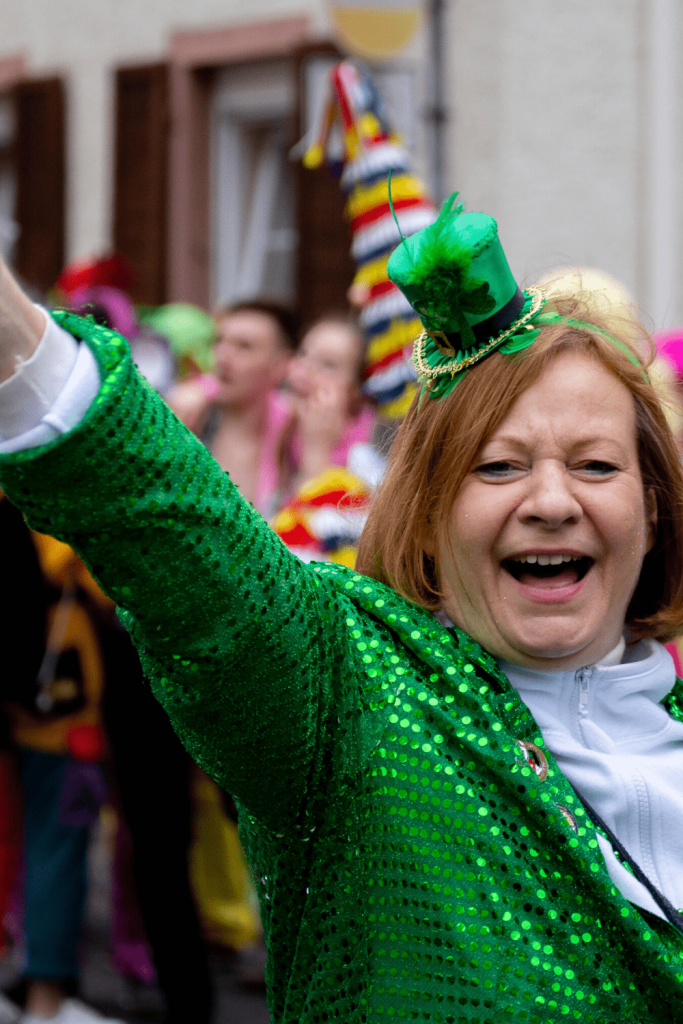 Person dressed up as part of a carnival parade: Alaaf! Image: Cooper Le on unsplash.