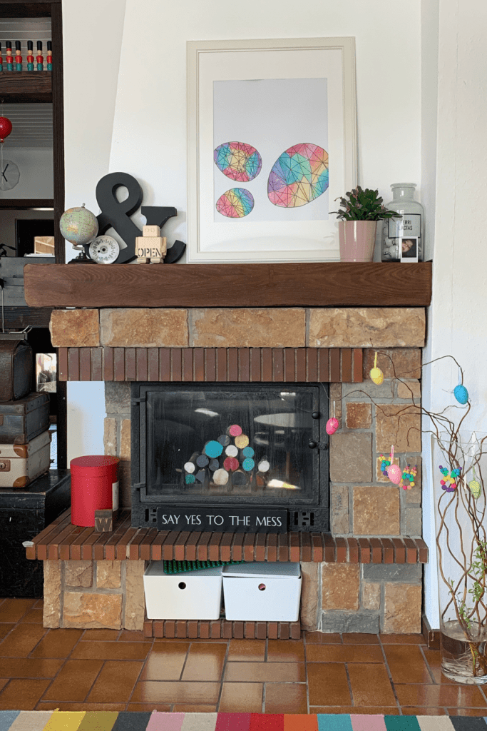 Image of our fireplace, after we purged, sorted and corralled the toys that were threatening to take over