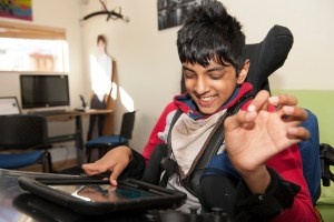 Image of a child using technology in a hospice