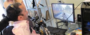 Image of a disabled person gaming with SpecialEffect technology