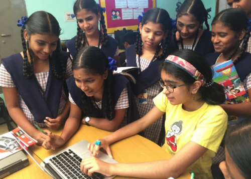 Nishka Mathur with some girls around a computer