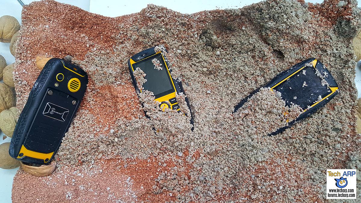Kenxinda Ruggedised Smartphones In Coarse Wet Sand