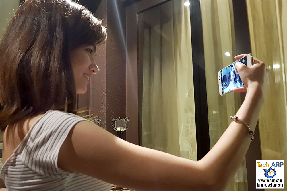 Taking a selfie with the ASUS ZenFone 4 Selfie Pro smartphone