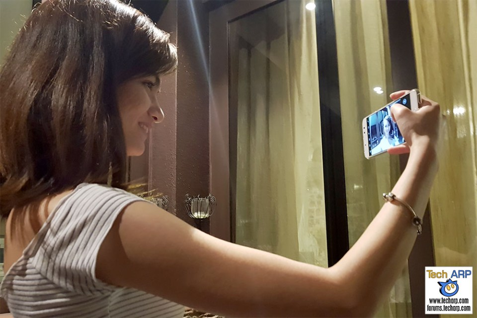 Taking a selfie with the ASUS ZenFone 4 Selfie Pro smartphone