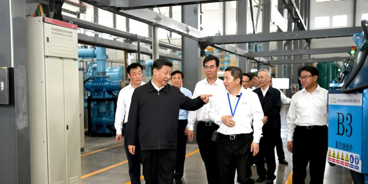 Xi Jinping and Liu He at rare earth factory May 2019