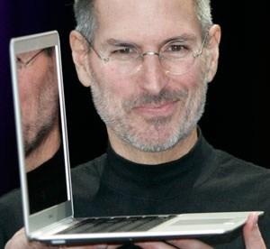 Steve Jobs Showing MacBook Air