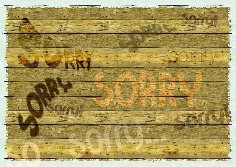 Several Sorry Text on Wooden Board