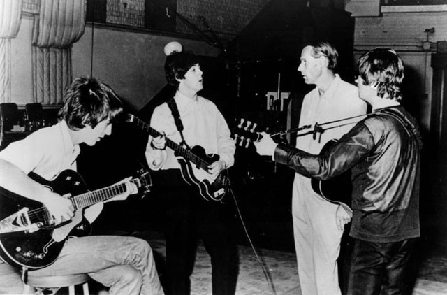 The Beatles in the recording studio with producer George Martin in 1966. Capitol Records