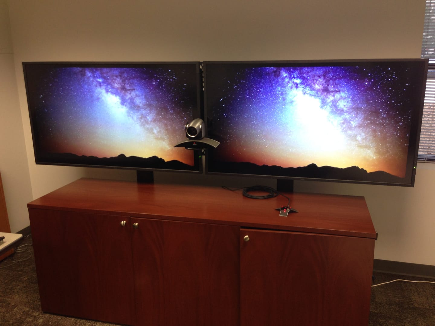 "Dual 65"" monitors on a custom credenza designed for AV."
