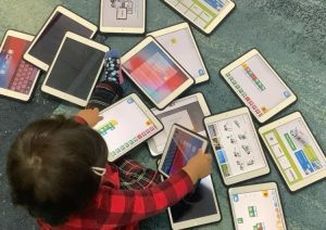 child with multiple tablets