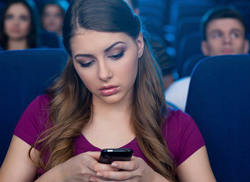 texting-in-a-cinema