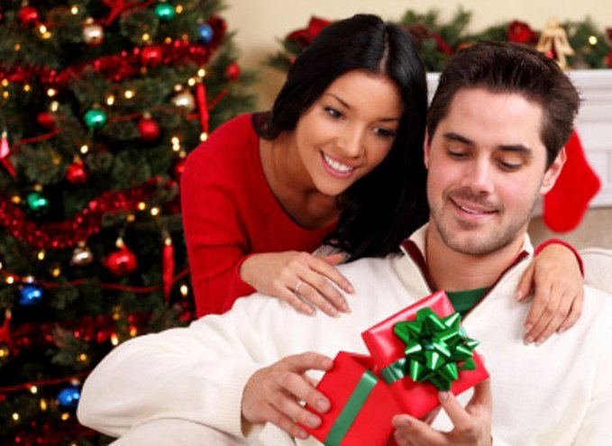 man-opening-christmas-gift