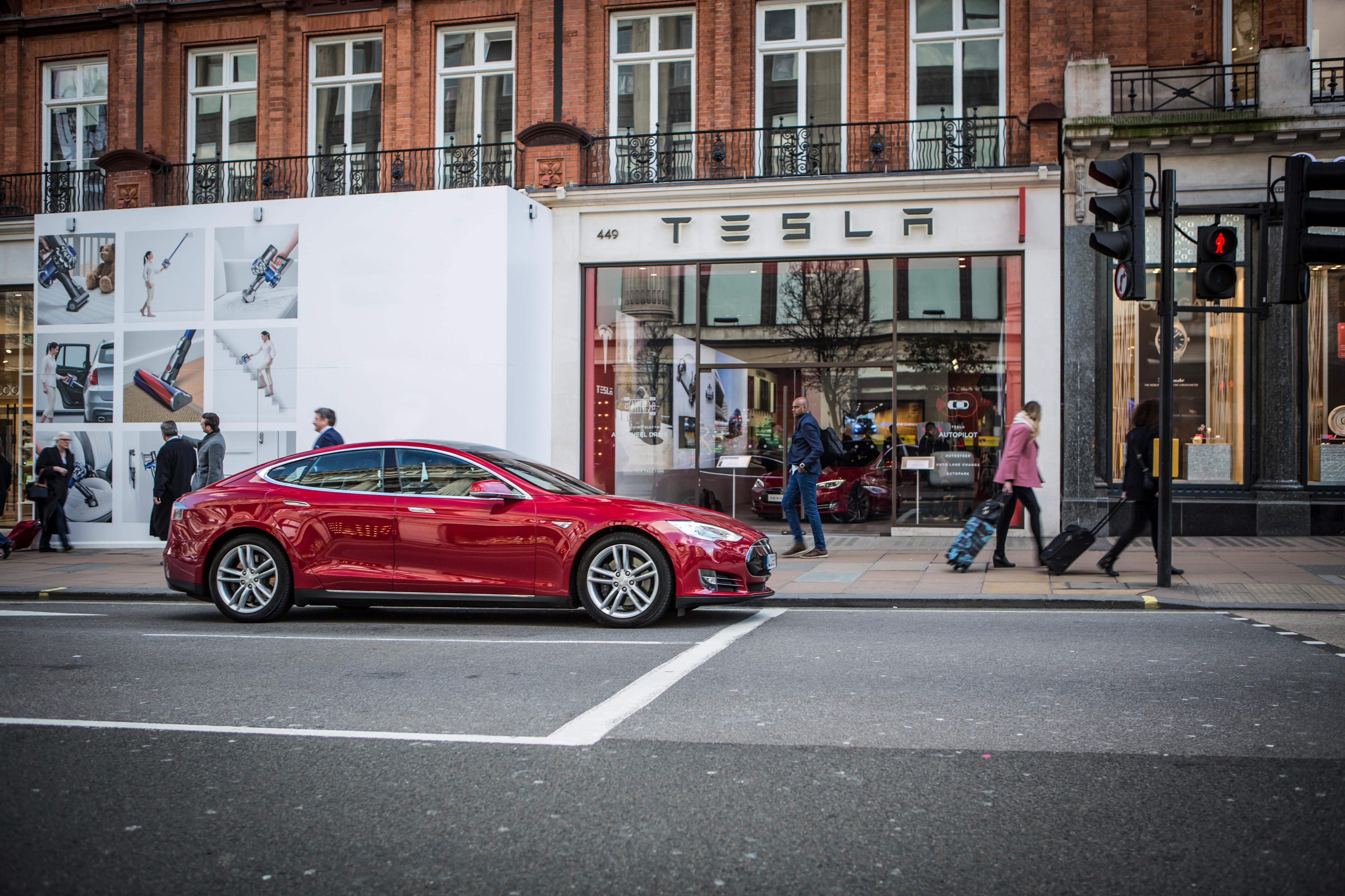 The tesla model s parked outside the company s flagship oxford