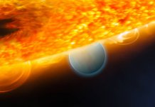 """This is an artist's impression of the Jupiter-size extrasolar planet, HD 189733b, being eclipsed by its parent star. Astronomers using the Hubble Space Telescope have measured carbon dioxide and carbon monoxide in the planet's atmosphere. The planet is a """"hot Jupiter,"""" which is so close to its star that it completes an orbit in only 2.2 days. The planet is too hot for life as we know it. But under the right conditions, on a more Earth-like world, carbon dioxide can indicate the presence of extraterrestrial life. This observation demonstrates that chemical biotracers can be detected by space telescope observations. Credits: ESA, NASA, M. Kornmesser (ESA/Hubble), and STScI"""