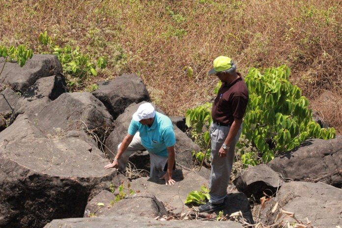 Toppled pentagonal blocks (Prof N Pawar and Prof Vishwas S Kale during field work )