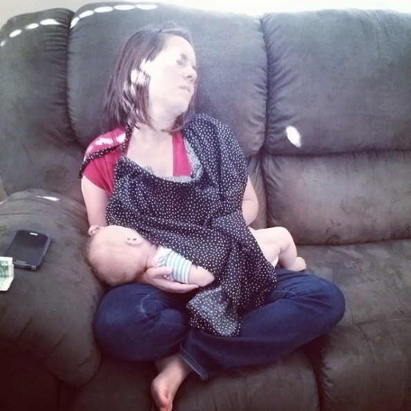 My husband caught this picture of me one afternoon when I'd fallen asleep sitting up, nursing our baby