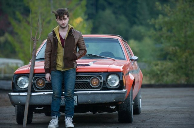 Lg Perrish (Daniel Radcliffe) poses for the camera on set